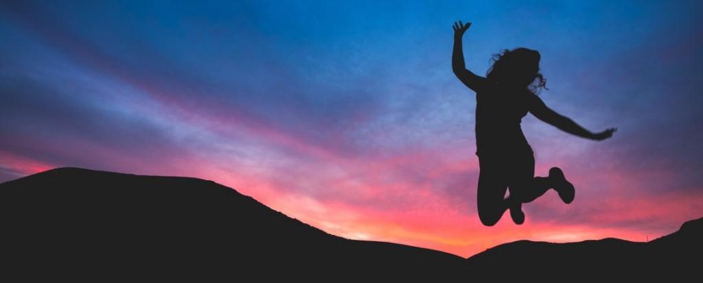 Child silhouetted - jumping for joy - Austin Schmid - Unsplash.com
