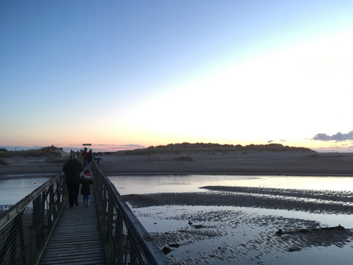 People cross the East Beach Bridge to the Easter Sunday Sunrise Service 2018, Lossiemouth, Moray