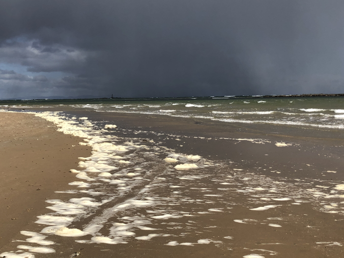 Spume and showers, West Beach, Lossiemouth